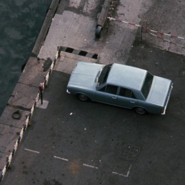 Carter parks his car on the Quayside, by the Tyne Bridge